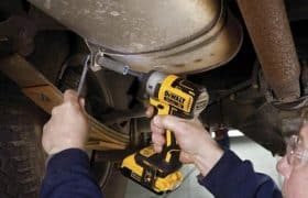 Man using a DeWalt impact driver