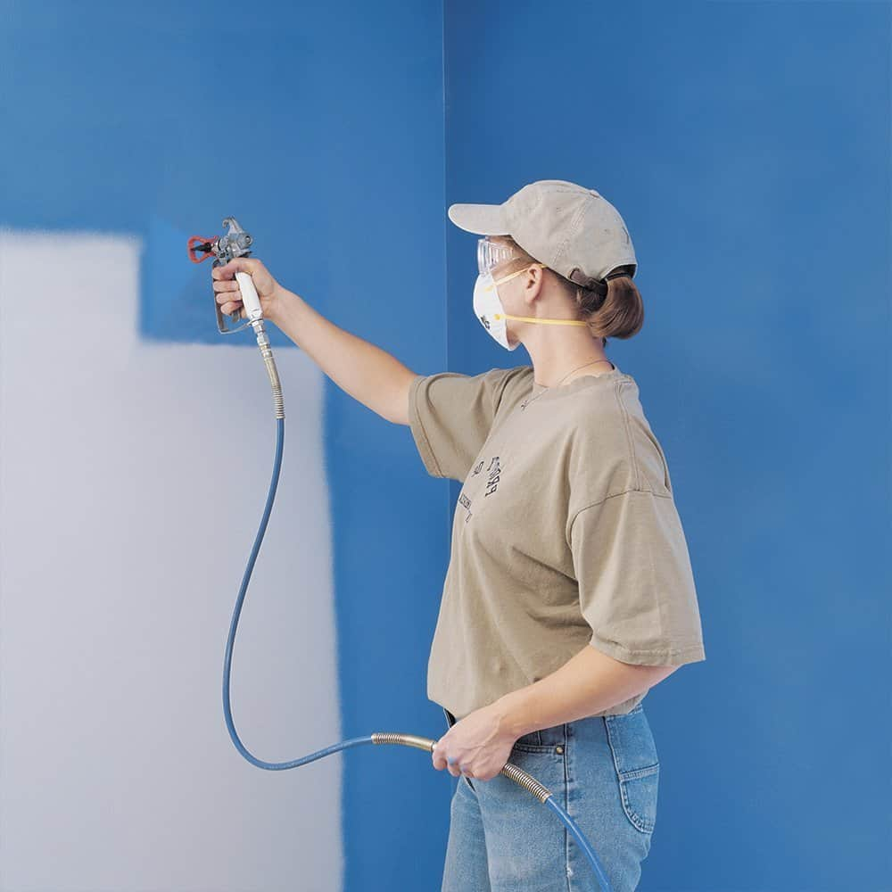 Lady using an airless paint sprayer machine