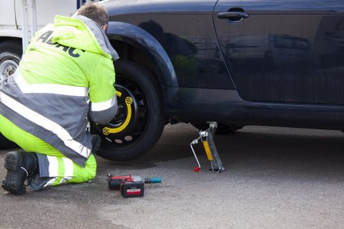 impact wrench removing a car tire lug nut